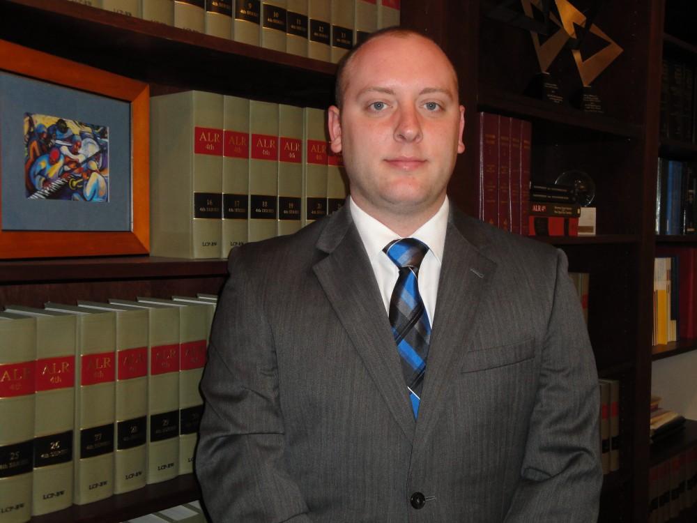Zac Oswald, Legal Aid Society