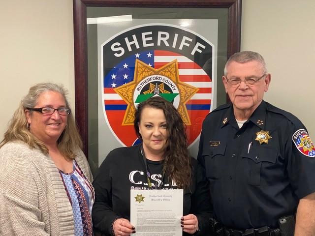 Sheriff Mike Fitzhugh, Dispatcher Jenny Mathias and Communications Lt. Candi McCluskey