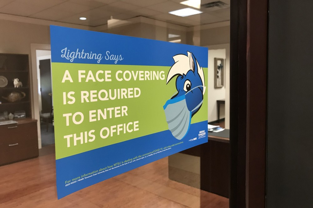 """Lightning says """"A face covering is required to enter this office"""""""