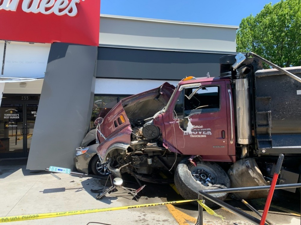 Derrick Hoover Trucking dump truck struck the Hardee's restaurant located at 255 South Lowry Street in Smyrna.