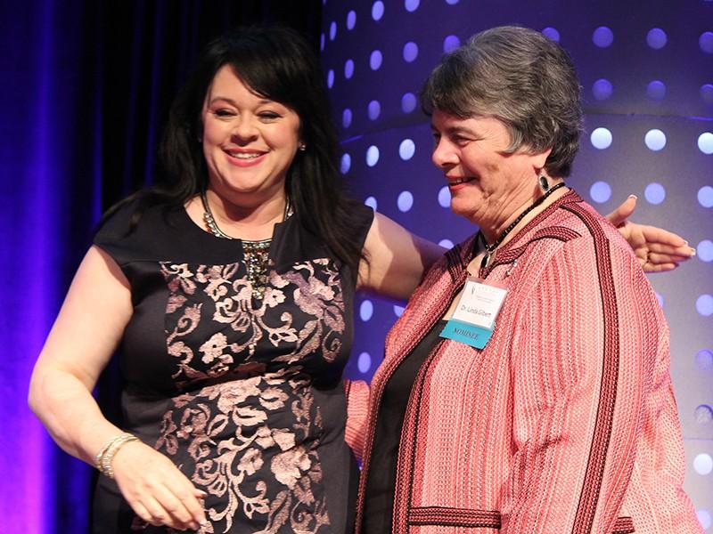 Linda Gilbert, right, and Amelia Bozeman at the 2019 ATHENA Award Ceremony