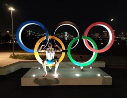 After arriving in Tokyo, on July 18, Michael Hicks posed with the Olympic Rings.
