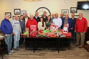 The Murfreesboro Optimist Group donates to the Child Advocacy Center Secret Santa Program.