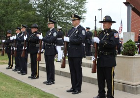 Honor Guard members prepare for the 21-gun salute during the 9-11 Remembrance Ceremony in 2017.