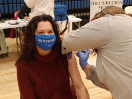 MTSU Health Promotion Director Lisa Schrader receives the Moderna vaccine Wednesday, Dec. 23, at the Siegel High School Gym in Murfreesboro.