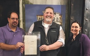 Rutherford Work Center Director Bill Cope donates historical document to Alcatraz East