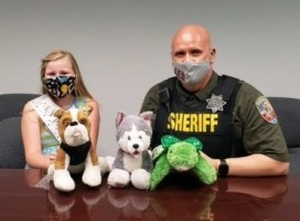 School Resource Officer Chad Dodson, left, and Lascassas 4th grade student Gabrielle Baron