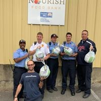 Photo attached: standing, left to right are Firefighter Delon Eckles, Firefighter Camron Phelps, Firefighter Danny Fields, Firefighter Austin Pytleski, Firefighter Jerry Mosely; kneeling is William Lambert with Nourish Food Bank